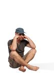 Terribly bored torist. A terribly bored tourist sitting on the ground isolated on a white background Stock Image