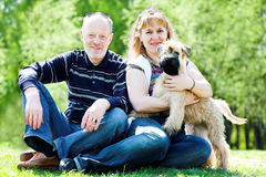 Terrier dog and family. Irish soft coated wheaten terrier dog and family Stock Photos
