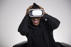 Terrified African American man playing vr game Stock Images
