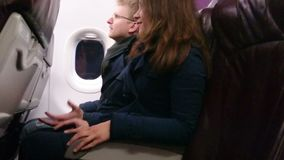 Terrified airliner passengers holding hands, hugging. Plane crashing, falling. Stock footage stock footage