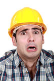 Terrified builder Royalty Free Stock Image
