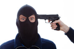 Terrified burglar with pistol Royalty Free Stock Image