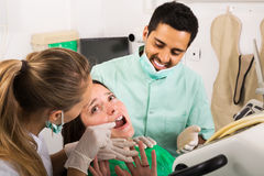 Terrified client and dental clinic Stock Photography