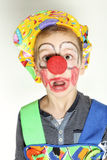 Terrified clown with red nose and yellow hat Stock Photos