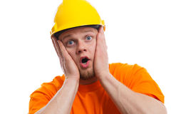 Terrified construction worker. Isolated white Royalty Free Stock Photography