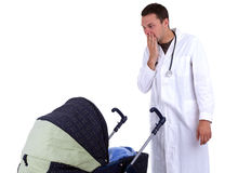 Terrified doctor looking to baby pram Stock Photo