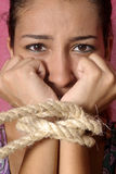 Terrified female prisoner. Beautiful brunette girl tearful and anxious Stock Photography