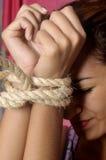 Terrified female prisoner royalty free stock photo