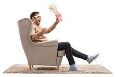 Terrified guy with 3D glasses and popcorn Stock Images