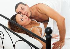 Terrified lovers caught during adultery Stock Images