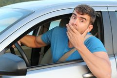 Terrified male driver feeling guilty.  stock photos