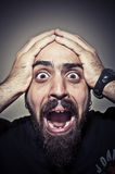 Terrified man Stock Images