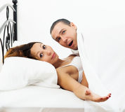 Terrified man caught during sex with girlfriend Stock Photos