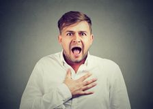 Terrified man posing at camera royalty free stock photo