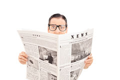 Terrified man reading a newspaper royalty free stock photography