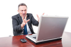 Terrified manager seeing something on laptop and screaming. Terrified manager seeing something bad on laptop and screaming isolated on white studio background Stock Photo