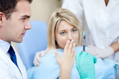 Terrified patient at the dentist Stock Photo