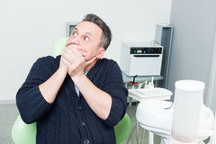 Terrified patient in dentist office Royalty Free Stock Photos