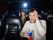 Terrified People Watching Film Royalty Free Stock Photography
