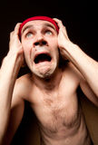 Terrified screaming man holding his head Royalty Free Stock Images