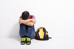 Terrified student  sitting on the floor Royalty Free Stock Photography