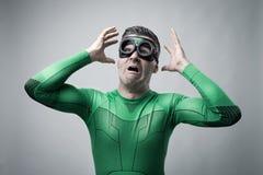 Terrified superhero with hands raised Stock Photo