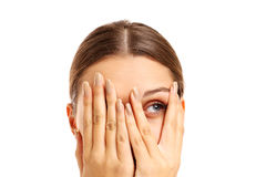 Terrified woman covering her face Royalty Free Stock Photos