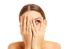 Terrified woman covering her face Royalty Free Stock Image