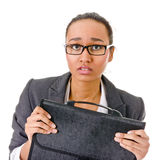 Terrified young business woman on white. Young woman with dark skin in a business suit afraid Stock Photography