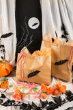 Terrifying candy. Bags filled with candy in a Halloween party setting Royalty Free Stock Image