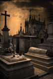 Terrifying cemetery. Spooky Halloween european graveyard with dark clouds Royalty Free Stock Images