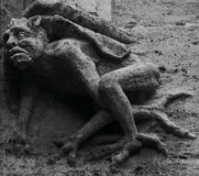 Terrifying creature. Shot in black and white, detail on a sculpture in Valencia, Spain Stock Image