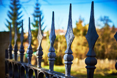 Terrifying fence with spearheads. Fence with finials before private property Royalty Free Stock Photo
