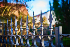 Terrifying fence with spearheads. Fence with finials before private property Stock Photography