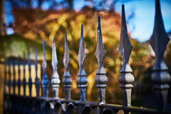 Terrifying fence with spearheads. Fence with finials before private property Royalty Free Stock Images