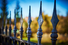 Terrifying fence with spearheads. Fence with finials before private property Stock Image