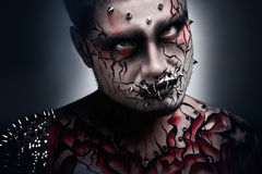 Terrifying look. A creepy portrait of a pierced halloween moor with bloody body art Royalty Free Stock Photo