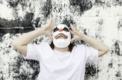 Terrifying scary clown. Crazy clown mask halloween costume and fear stock image