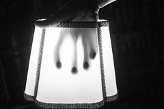 Terrifying shadow hand. Hand in lamp shade terrifying, fear and fright Stock Images