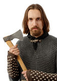 Terrifying warrior. In armour, holding an axe, isolated over white background Stock Photos