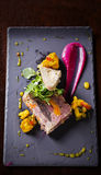 Terrine. Slice of terrine with cauliflower and sauces on slate board Royalty Free Stock Photo