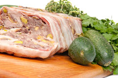Terrine on a wooden board. With vegetables Royalty Free Stock Image