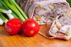 Terrine on a wooden board. With vegetables Stock Photos