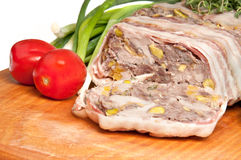 Terrine on a wooden board. With vegetables Royalty Free Stock Photos