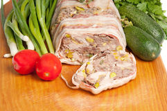 Terrine on a wooden board. With vegetables Royalty Free Stock Photography