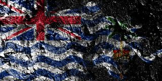 Territoires d'outre-mer britanniques - drapeau mystique fumeux de territoire d'Océan Indien britannique sur le vieux fond sale d illustration libre de droits