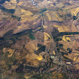 Territory and fields with a small town and road in aerial view. Territory divided into fields with a small town and road in aerial view Stock Images