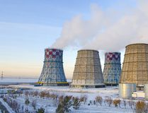 Territory of heat and power station. Accumulator tanks and cooling towers. Close-up. Winter royalty free stock photos