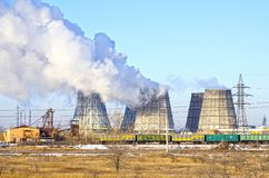 Territory of heat and power station. Accumulator tanks and cooling towers. Winter. Russia stock photography