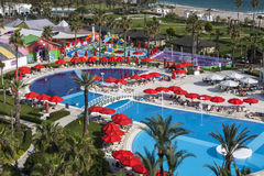 Territory of IC Hotels Santai Family Resort with swimming pool. Antalya, Turkey. People are relaxing by the pool under umbrellas Stock Photos